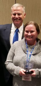District Attorney George Brauchler with advocate Colleen Vogel